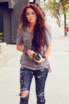 .loose tee, ripped jeans, layered bracelets, layered necklaces, boots, long hair, yep