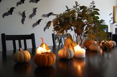 minimalist halloween decor and halloween tablescape using pumpkins candles and construction paper bats Halloween Table Decorations, Halloween Home Decor, Halloween House, Holidays Halloween, Halloween Crafts, Halloween 2020, Halloween Party, Seasonal Decor, Fall Decor