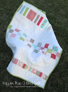 Ruby Scrap Quilt back by Happier Than A Bird Quilts