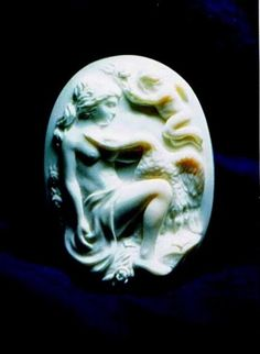 Leda and Swan. Sea Shell.   Cameo. Height relief is carved on white -rose colored seashell