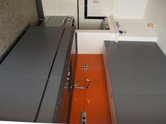 Grey and orange kitchen