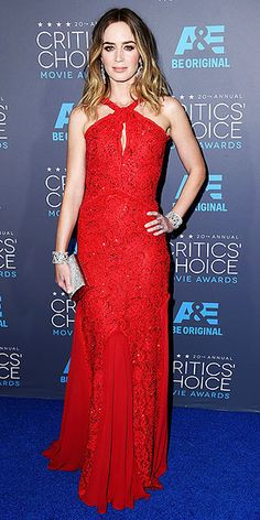 Must-See Looks from the Critics' Choice Awards | EMILY BLUNT | She's red hot! Best actress in an action movie winner Emily sizzles in a scarlet Emilio Pucci beaded gown paired with dazzling ear and wrist bling and a silver clutch.