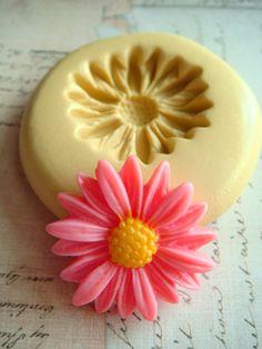 Daisy Blossom - Flexible Silicone Mold - Push Mold, Jewelry Mold, Polymer Clay Mold, Resin Mold, Craft Mold, Food Mold, PMC Mold. $5.99, via Etsy.