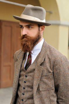 light brown tweed/herringbone suiting + beige hat