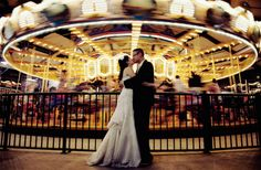 Kissing in front of the Merry Go Round.