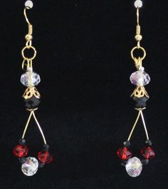 red, black and clear Swarovski crystal with gold tone wires.  Earrings