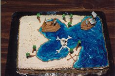 9th in Birthday Cake Creations series: Aarrgh! Pirate Adventure! I bought the blue gel water icing, and black colorings. Even the palm trees are handmade and edible.