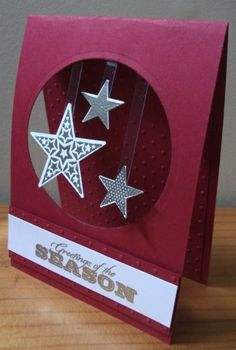 handmade Christmas card ... stars floating on acetate strips spanning negative circle space .. fun look ... Stampin' Up!