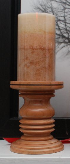 Wood turned candle stand in cherry