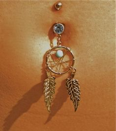 belly button piercing, as hipster as it is i really like the dream catcher ones.
