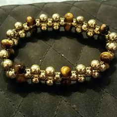 Stunning bracelet This bracelet is so pretty, gold beads accented by tan and brown darker beads.  This bracelet is expandable and will fit most. Jewelry Bracelets