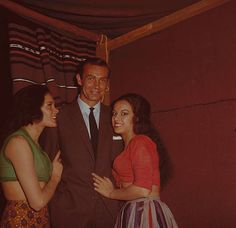English actress Martine Beswick (left) and Israeli actress Aliza Gur (right) who play gypsy girls Zora and Vida in the James Bond film From Russia With Love posed with Sean Connery on set at Pinewood Studios in England in 1963.