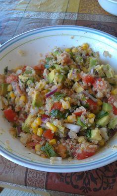 Summer salad...quinoa, avocado, corn, tomato, red onions, cilantro, black pepper, freshly squeezed lime!