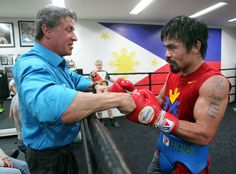 Stallone and Pacquiao touch fists before Pacquiao works the punch mitts. Photo by Chris Farina - Top Rank