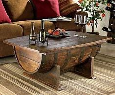 Whiskey Barrel Coffee Table  Add some character to your home with these hand made whiskey barrels that have been converted into coffee tables. Using recycled aged oak whiskey barrels, these unique coffee tables feature a built in storage area and are hand stained for that polished yet rustic look.