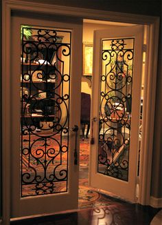 Faux Iron Grillwork...would love these for our french doors in the den.