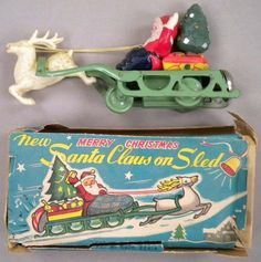 Santa Claus on Sled 1940s Tin Celluloid Wind Up Toy Original Box, Japan.  I have this wonderful toy that belonged to my Grandmother.  I treasure it!
