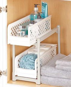 The 2-Tier Sliding Bathroom Storage Shelf lets you arrange the contents of your cabinet so that everything is easier to find. The shelves feature lips on the fronts to keep items in place and make pulling them in and out simple. Perforated sides allow yo