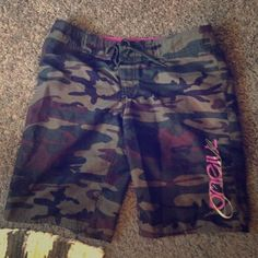 Women's camo board shorts with pink and white! O'neill brand women's board shorts size 5 (fits like a medium!) camouflage with pink and white details and writing! Lightly worn! O'Neill Shorts