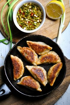 Crispy pot stickers (Chinese dumplings) with spicy mushroom and spinach filling