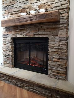 contemporary living room stacked stone fireplace wooden mantel