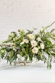 green and white greek inspired wedding reception centerpiece for a santorini greece wedding at moniker warehouse