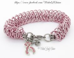 Viperscale Chainmaille bracelet in jewellers grade anodised aluminium.  Silver tone breast cancer awareness charm studded with pink rhinestones.  Stainless Steel Lobster clasp closure and extension chain.