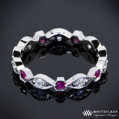 Rubies and diamonds - Would love to have something like this for a family ring..its perfect!
