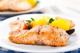 Salmon with oranges tomatoes and olives