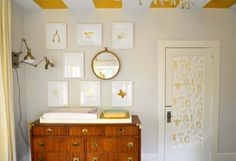 From the gold foil art gallery wall to that amazing campaign dresser-turned-changing-changing table, we have fully embraced gold in the nursery!