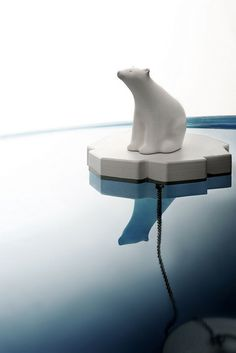 Drain Stopper! Little polar bear floats on his berg while anchored to the stopper below.