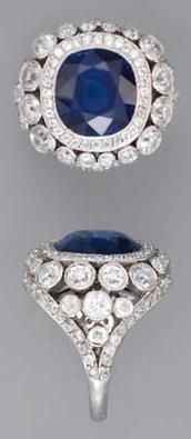 A SAPPHIRE AND DIAMOND RING The cushion-shaped sapphire weighing 7.41 carats
