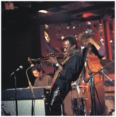 RONNIE SCOTTS Photo of Miles DAVIS and Dave HOLLAND and Chick COREA, L-R: Chick Corea, Miles Davis, Dave Holland – performing live onstage for BBC 'Jazz Scene' TV show 02 Nov – 1969