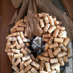 DIY wine cork wreath with burlap bow...very into burlap bows lately for some reason.