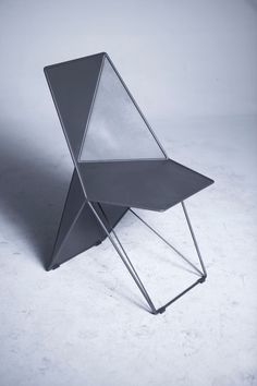 Handmade from metal, the Monumental Chair, designed by Eray Carbajo, references crystalline forms typically found in nature. It's faceted, geometric structure wraps around the back for comfort while creating a sculptural silhouette. Deck Furniture, Furniture Design, Architecture Design, Journal Du Design, Multipurpose Furniture, Inexpensive Furniture, Cool Chairs, Sofa Chair, Modern Chairs