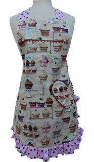 This reversible full apron offers full coverage of your clothing yet very dainty, with a ruffle encircling the lower half. The fabric is cream color with muted shades of blue pink and brown. It has different cupcakes with cupcake recipes all over it. The opposite side is a polka-dot fabric. It has a heart pocket. This is also available in child ($24) and baby ($18) sizes.