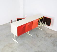 Double Sided Sideboard by Raymond Loewy for DF 2000 | From a unique collection of antique and modern sideboards at https://www.1stdibs.com/furniture/storage-case-pieces/sideboards/