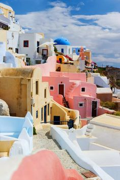 Colorful Santorini, Greece....this almost looks like a painting, a really beautiful painting. I love these types of houses. And the colors!