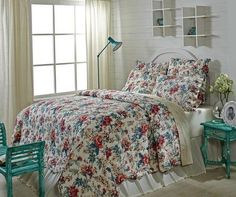 Give your room a fresh update with our Isabella quilted bedding in a floral print with gorgeous reds and teal colors. https://www.primitivestarquiltshop.com/collections/isabella-bedding #primitivecountrybedroomsbeddingandaccessories