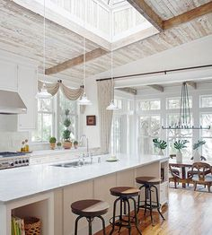 Love the old wood ceiling and skylight Also like the option to draw the drapery and section off the dining from a (perhaps) messy kitchen!