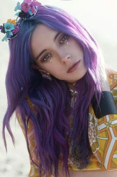 A Purple hair Princess wears crown of flowers and cries tears of glitter