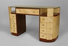 """French Art Deco mahogany and parchment veneered """"D"""" shaped dressing table desk with a glass top over sides of an open shelf and 4 drawers"""