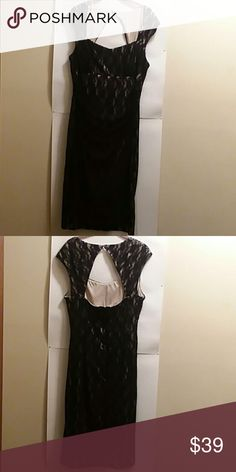 """LONDON STYLE OPEN BACK SHEATH DRESS, SIZE 16 PLEASE FEEL FREE TO ASK QUESTIONS BEFORE  PURCHASE  NWOT COLORS: BLACK LACE  OVERLAY WITH NUDE LINING OPEN BACK BUTTON CLOSURE AT THE BACK ZIPPER IN THE BACK  40"""" LONG FROM THE SHOULDER  SHELL: 90% NYLON  10% SPANDEX  100% POLYESTER LINING LONDON STYLE Dresses Midi"""
