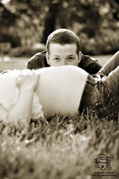 Lol would be cute if he was kissing her belly! Couple Maternity Photography Poses