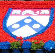 The Penn seal surrounded by red and blue flowers!