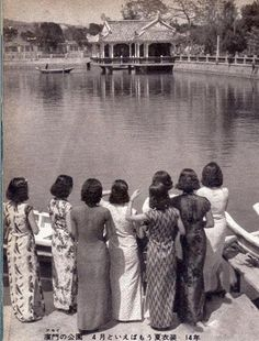 f2401c5569ab69 Eight ladies wearing different styles of Qipao were in a garden of Xiamen