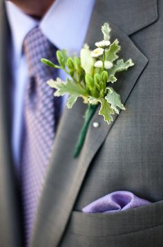 A colorful, patterned tie is best paired with a simple boutonniere, ensuring the two elements don't compete.