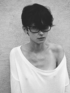 short hair, big glasses
