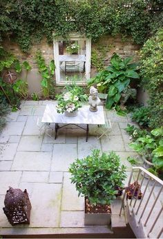 secluded patio: I should put a mirror outside outdoor-tables