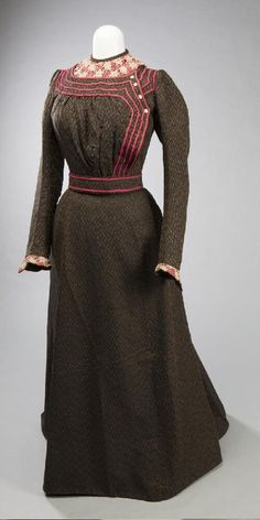 Women's two-piece wool dress of black and brown, with pink trim and accents and matching belt, belonging to Elizabeth Feddersen, ca. 1900. Missouri History Museum. collections.mohistory.org #fashionhistory #1900sstyle